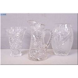Two crystal vases and a crystal handled pitcher
