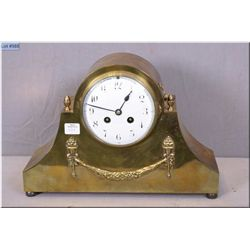 A brass cased top hat chiming mantle clock, working at time of cataloguing
