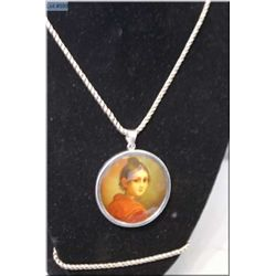 Hand painted glazed porcelain cameo in silver bezel with chain