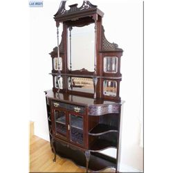 Victorian étagère with multiple mirrored backboard, two glazed doors, delicate carving and scroll su