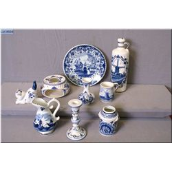 A selection of Delft pottery including candlestick, plate, pitcher, small cat figurine etc.