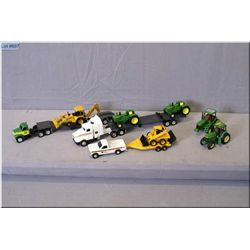 A selection of John Deere toy trucks and tractors