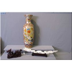 """An Oriental floor vase 24"""" in height and two Oriental figures including a carved style dragon on a w"""