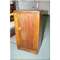 A vintage floor radio cabinet converted to cupboard