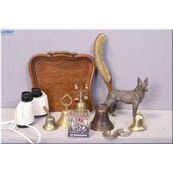 Antique quarter cut oak dust pan with brush, assortment of brass and cast bells, gyroscope, Expo bin