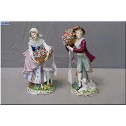 """A pair of marked Capodimonte figurines including a boy and girl with flowers and sheep, 7 1/2"""" in he"""