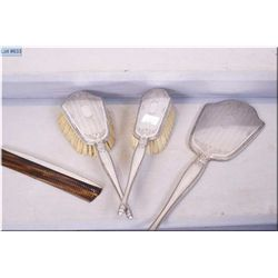 Dresser set including two brushes, comb and mirror all marked Birks Sterling