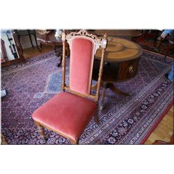 Antique Victorian chair with upholstered seat and back and carved back support on original castors