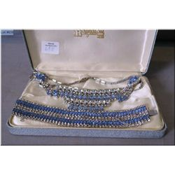 Vintage rhinestone necklace, earrings and bracelet set with white diamante and plate blue crystals.