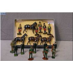 A selection of Britains metal soldiers including Hussars, four horses and five riders and nine metal