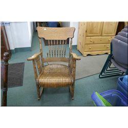 Antique oak spindle back rocking chair