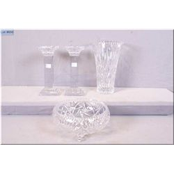 A selection of crystal including footed pinwheel fruit bowl, a pair of heavy candlesticks and a flow