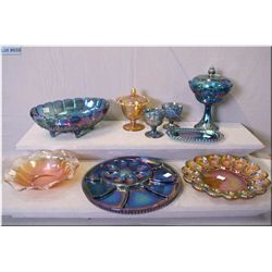 Selection of vintage carnival style pressed glass including lidded comport, footed dish, cream and s