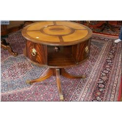 Antique leather insert drum table with Regency style center pedestal with brass capped feet and orig