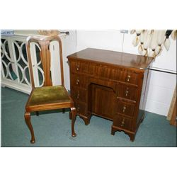 Interesting antique kneehole desk with original pulls, eight drawers and a cubby hole plus a Queen A