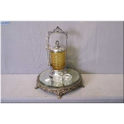 A silver plate and amber glass pickle castor, two open salts and a footed mirrored silver plate tray