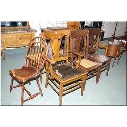 Five matching dining chairs, and an oak armchair with leather seat