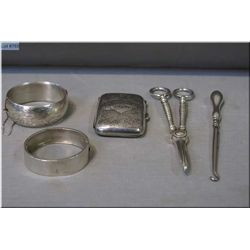 A sterling silver bracelet, cigarette case and pick hook as well as a bracelet and scissors.