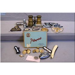 A selection of vintage collectibles including cigarette lighters and tin, brass RCAF buttons, patche