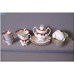 Antique porcelain tea set including eight cups and saucers, teapot, creamer, etc.