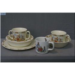 A selection of Royal Doulton Bunnykin children's dishware including cereal bowl and mug, porridge bo