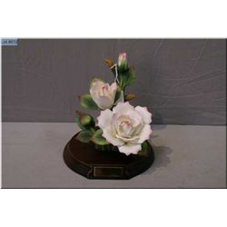 Porcelain flower on a wooden base