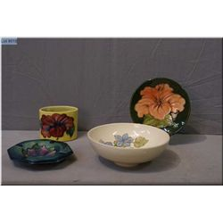 Four pieces of Moorcroft pottery including bowl, toothpick holder, ashtray and small pin tray
