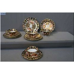 Four Royal Crown Derby Traditional Imari cups, saucers and side plates