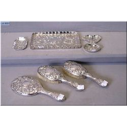 Heavily bas relief sterling silver dresser set including brushes, mirror, ring tree, pin trays, etc