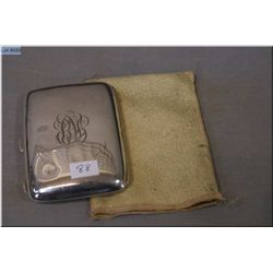A British sterling cigarette case with original tarnish resistant pouch