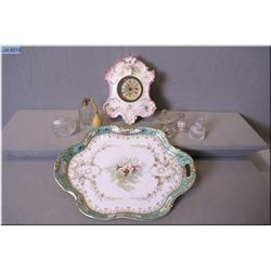 Porcelain vanity tray and a porcelain wall clock nd a selection of vintage perfumes