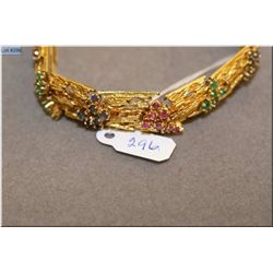 Lady's 18kt yellow gold, emerald, sapphire and ruby bracelet set with 30 1.92-9.2mm genuine rubies,