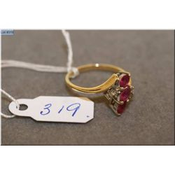 Lady's yellow gold ruby and diamond ring