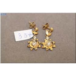 A pair of lady's yellow gold and diamond earrings