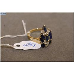 Lady's 14kt yellow and white gold, sapphire and diamond ring. Set with 1.20ct of marquise cut natura