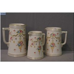 "Three vintage Crown Devon ""Perth"" pattern graduating jugs"