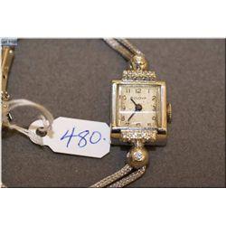 Lady's 14kt gold and diamond cased Bulova watch