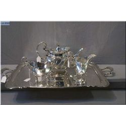 An antique British sterling tea service marked Henry Atkins, Birmingham 1853 with a matching tray ma