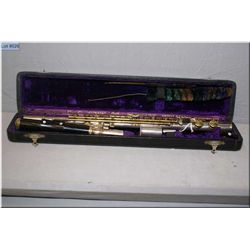 A vintage flute in hard case marked C.G. Connco. Elkhart, Indiana
