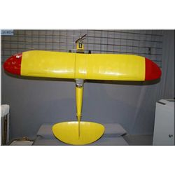 A large handmade gas powered model airplane
