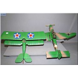 Two handmade gas powered model airplanes