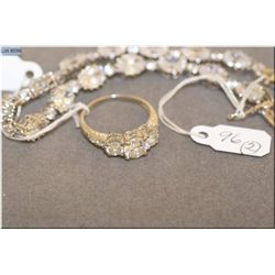 Lady's sterling silver and cubic zirconia bracelet and a sterling silver and cubic zirconia three st