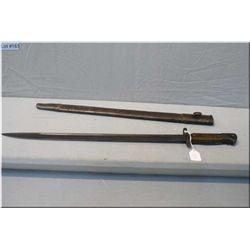 """A bayonet with a 17"""" blade in sheath"""