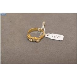 Lady's 10kt yellow gold and diamond ring set with 0.70ct of brilliant white channel set diamonds. Re