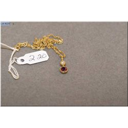 Lady's 18kt yellow gold, diamond and ruby pendant set with 0.36ct natural ruby and 0.07ct brilliant