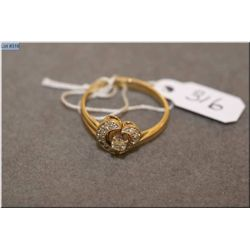 Lady's 14kt yellow gold and heart shaped ring set with diamonds