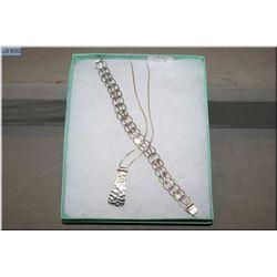 A sterling silver necklace, pendant and bracelet