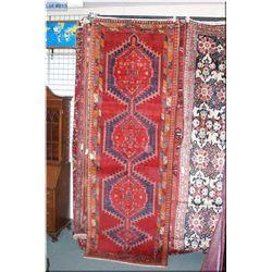 Azarbijan wool carpet runner with multiple geometric medallion, triple border in shades of raspberry