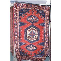 Wisse wool area carpet with triple medallion, geometric designs, triple border in shades of raspberr
