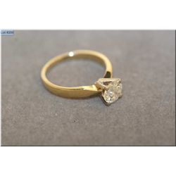 Lady's 14kt yellow gold solitaire diamond ring